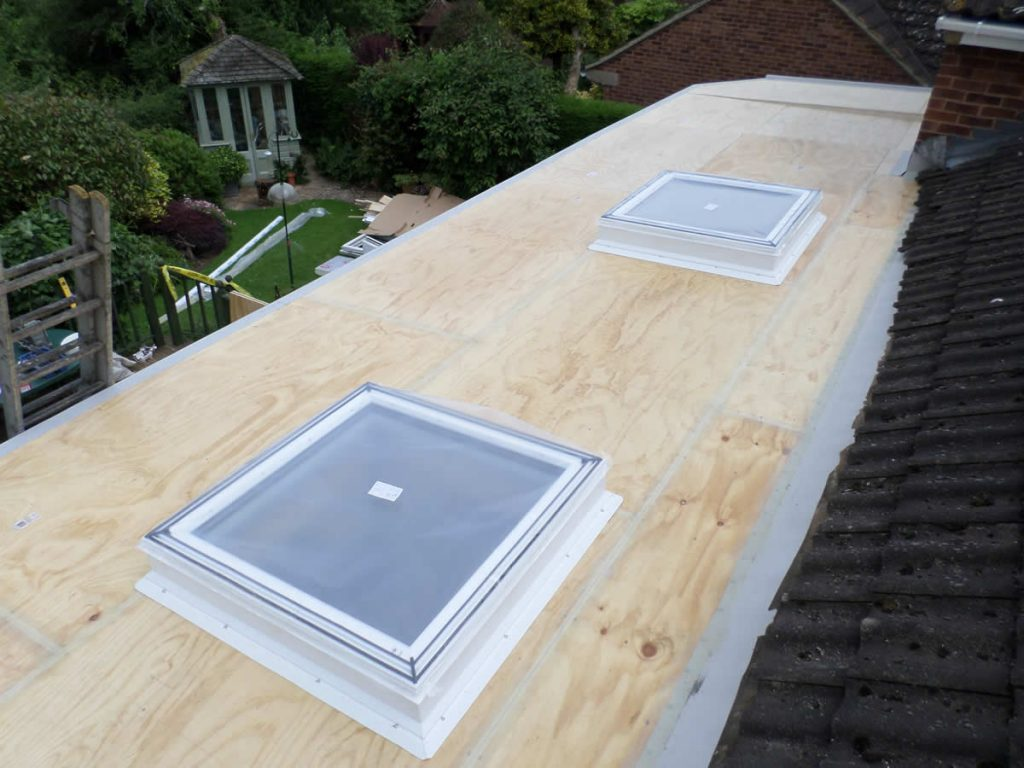 New roof sky lights on conservatory flat roof